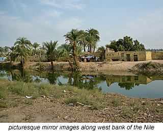 mirror images in Nile river on west bank Egypt