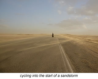 cycling into the start of desert sandstorm in Egypt