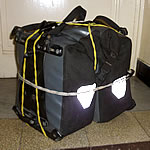 panniers wrapped with bungy cord